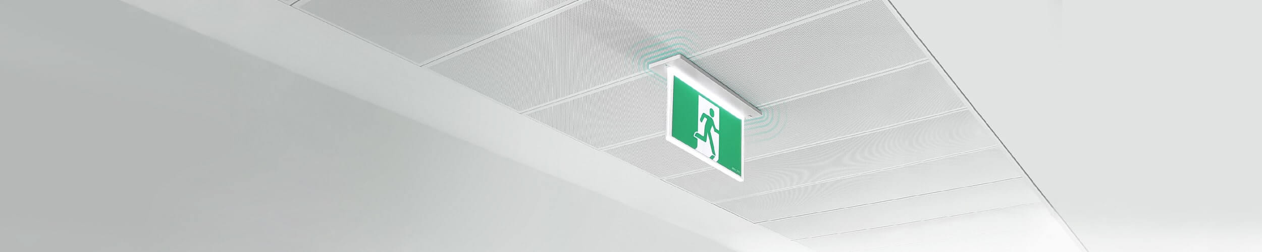 Recessed wireless emergency exit mounted in ceiling